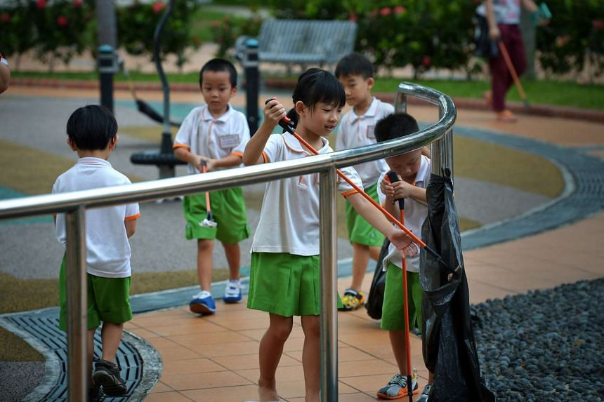 My First Skool kindergarten kids clearing rubbish. UniSIM students in the new full-time course will be required to do a six- month attachment at a childcare centre or kindergarten.