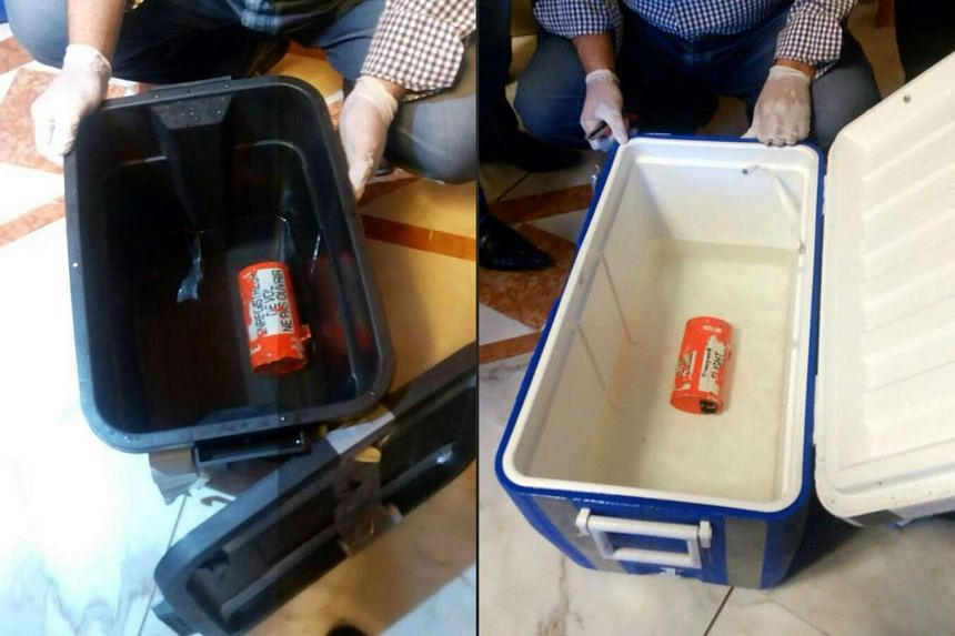 A combination photo showing the flight recorder (left), and one of the two black boxes of the crashed EgyptAir plane.