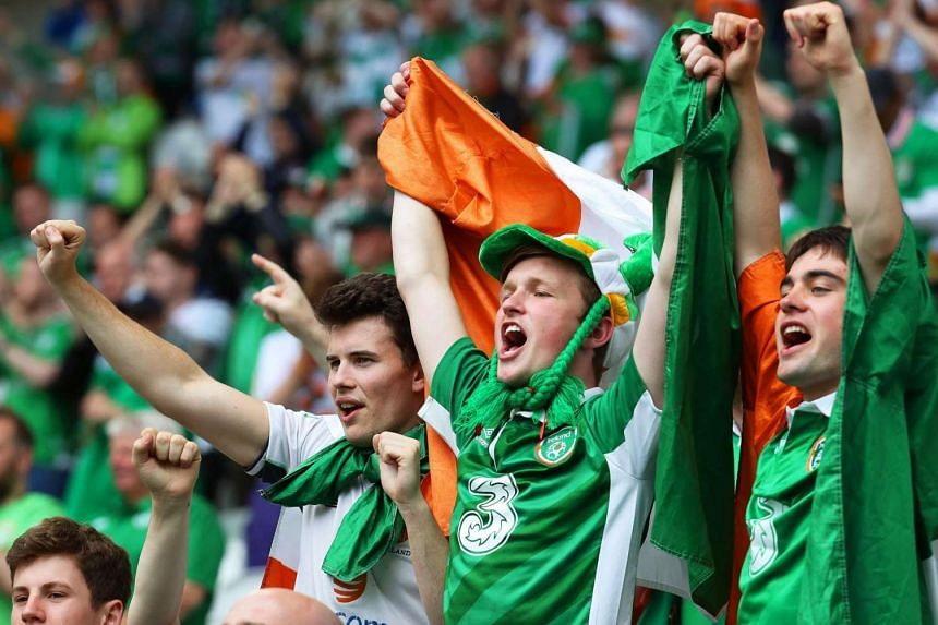 Irish fans cheer for their team during the Uefa Euro 2016 Group E preliminary round match between Belgium and Ireland in Bordeaux, France, on June 18, 2016.
