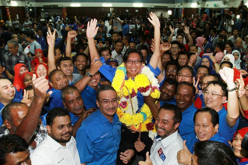 Barisan Nasional candidate Budiman Mohd Zohdi celebrates after Barisan Nasional won the  by-election for Sungai Besar, on June 18, 2016.