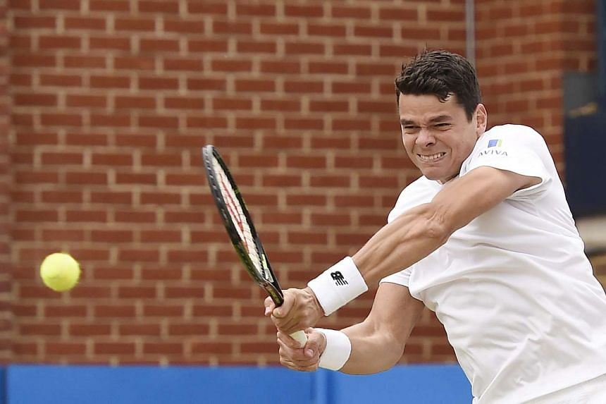 Canada's Milos Raonic returns the ball against Britain's Andy Murray during the final match at the Aegon Tennis Championships at the Queen's Club in London, Britain, on June 19, 2016.