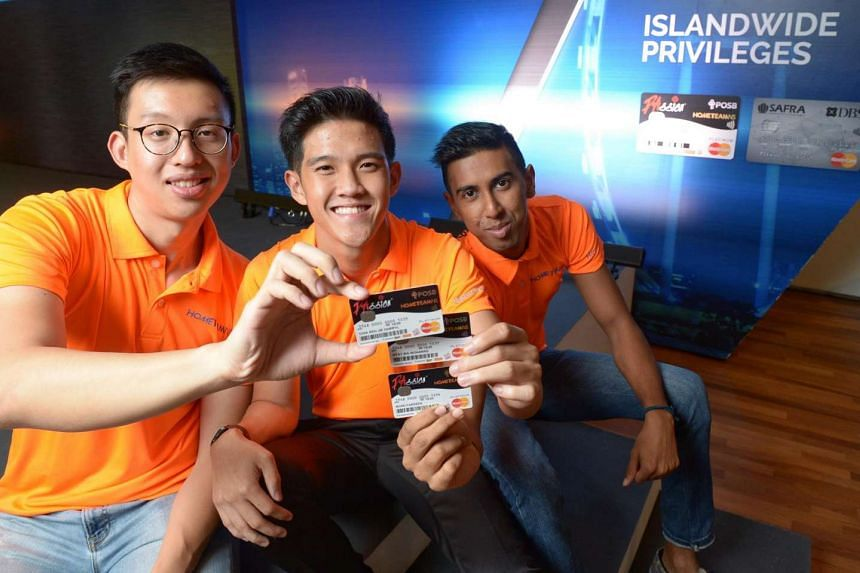 NSFs posing with their newly acquired HomeTeamNS-PAssion-POSB debit card on June 20, 2016.