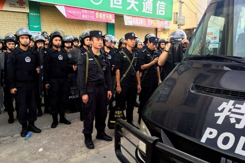 Policemen patrol at Wukan village in China's Guangdong province, on June 20, 2016.