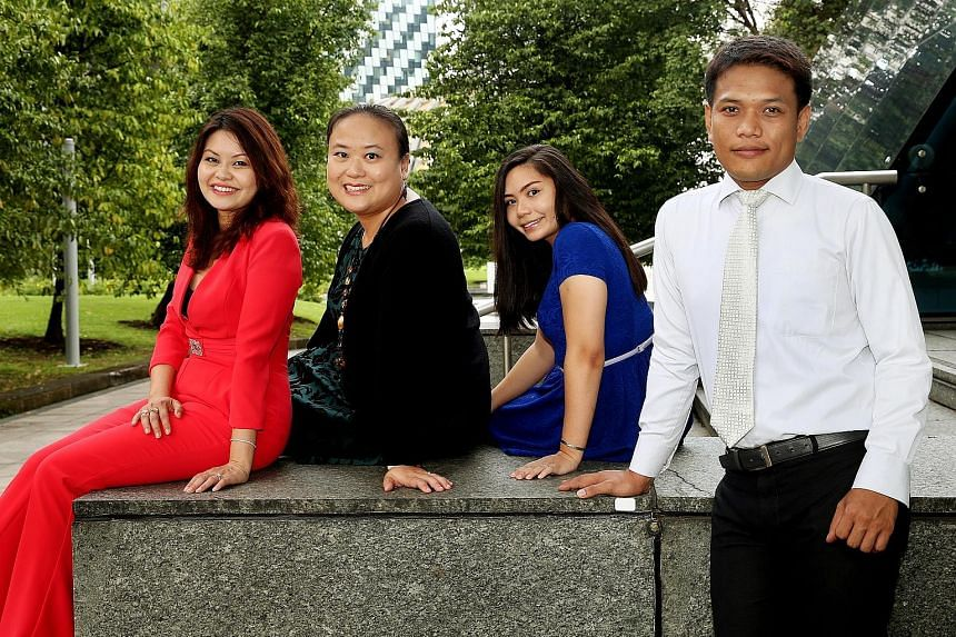 Ms Ling (in red), and some employees of her new firm (from left) Ms Ching, Ms Tania Ahchak, 24, and Mr Mohammad Nurmahadi, 38.