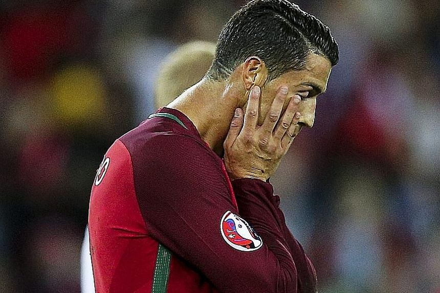 Cristiano Ronaldo could not cap breaking Luis Figo's appearance record for Portugal with a goal against Austria, fluffing his lines from 12 yards as his side could only draw 0-0.