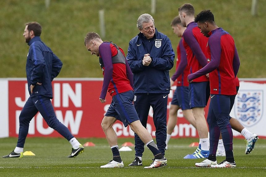 Former England striker Alan Shearer has called on manager Roy Hodgson (centre) to select Jamie Vardy (left) and Daniel Sturridge to replace the jaded Harry Kane and lead England's attack from the start against Slovakia, after the pair of substitutes'