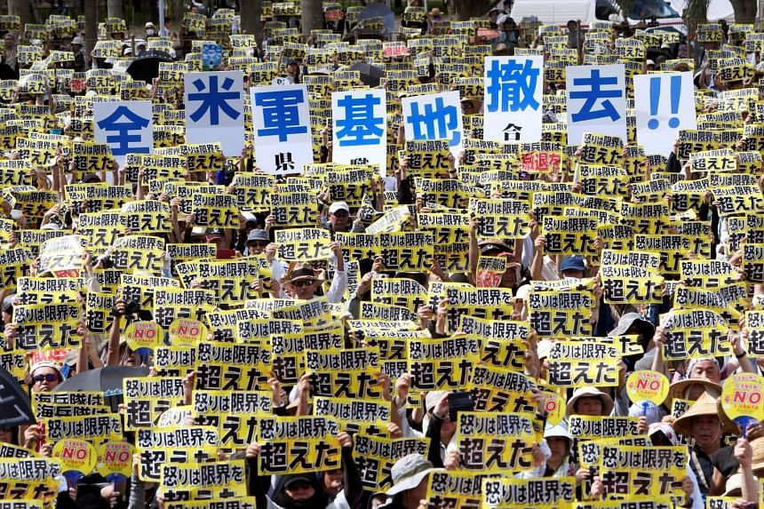 Protesters with placards reading 'Our anger has been pushed over the limit' and 'Remove all American bases' during the one of the biggest rallies against the US military presence on Okinawa in two decades. The protest was triggered after a series of