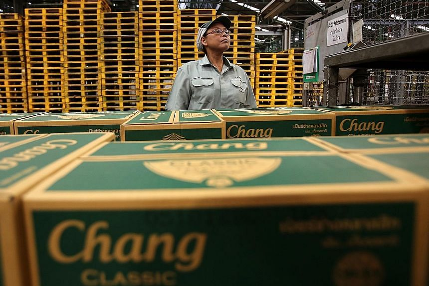 A worker inspecting Thai Beverage Chang beer at a brewery. Thai Beverage has been one of the few companies in the local market to remain resilient over the past month.