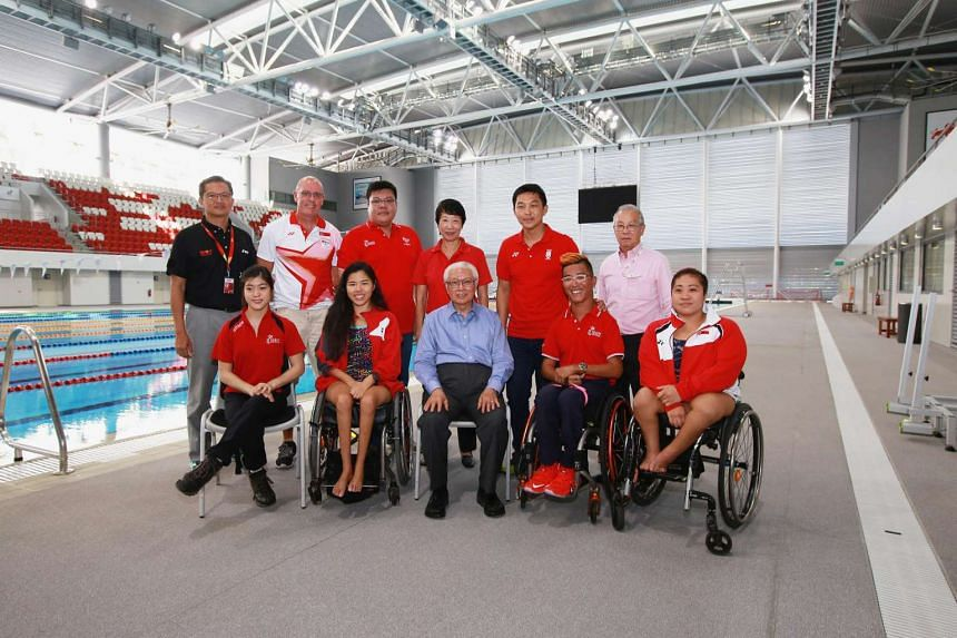 President Tony Tan Keng Yam with athletes who are training for the Olympics and Paralympics, on June 20, 2016.