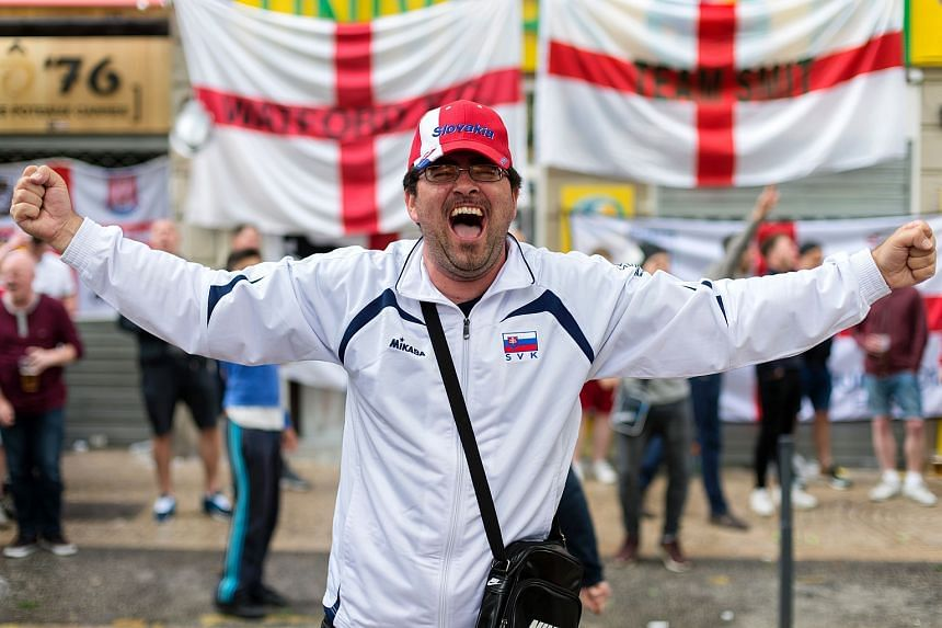 A Slovakia's supporter reacts in Jean-Jaures square in Saint-Etienne, central eastern on June 19, on the eve of the Euro 2016 group B football match between Slovakia and England.