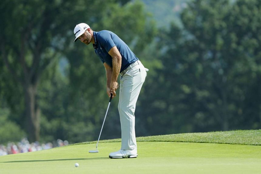Dustin Johnson of the United States putts on the third hole during the final round of the US Open at Oakmont Country Club.