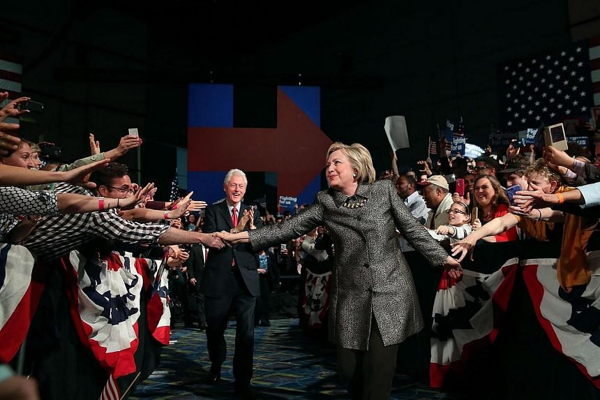 Hillary Clinton and former US president Bill Clinton greet supporters during a primary night gathering at the Philadelphia Convention Centre on April 26, 2016.