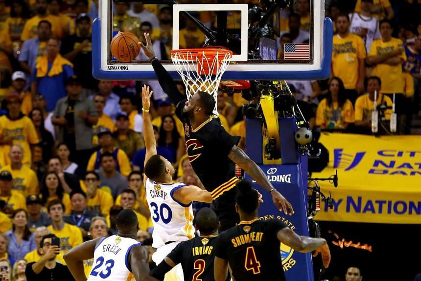 LeBron James #23 of the Cleveland Cavaliers blocks a shot by Stephen Curry #30 of the Golden State Warriors in Game 7 of the 2016 NBA Finals.
