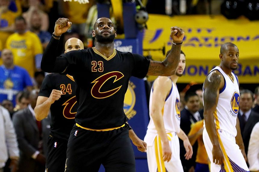 LeBron James #23 of the Cleveland Cavaliers celebrates in the final moments of Game 7 of the 2016 NBA Finals against the Golden State Warriors.