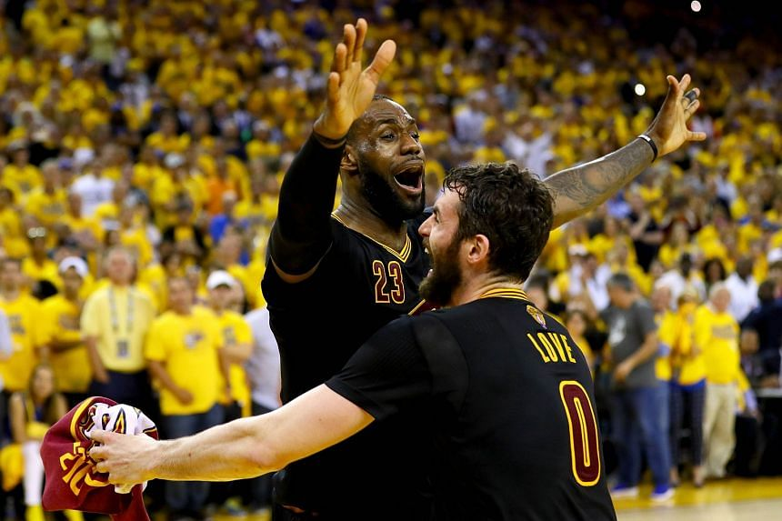 LeBron James #23 and Kevin Love #0 of the Cleveland Cavaliers celebrate after defeating the Golden State Warriors 93-89 in Game 7 of the 2016 NBA Finals.