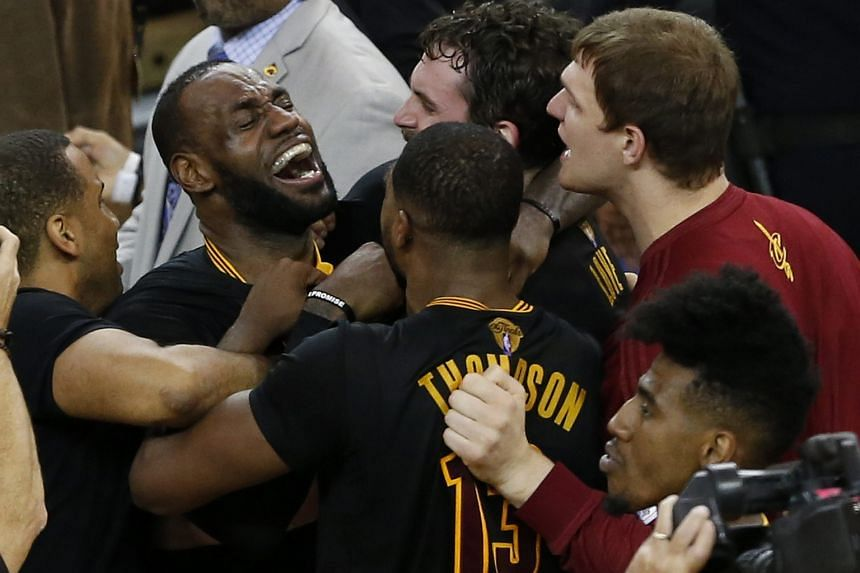 Cleveland Cavaliers players LeBron James (left), Tristan Thompson (centre) and Kevin Love (right) celebrate after beating the Golden State Warriors in the NBA Finals Game 7.
