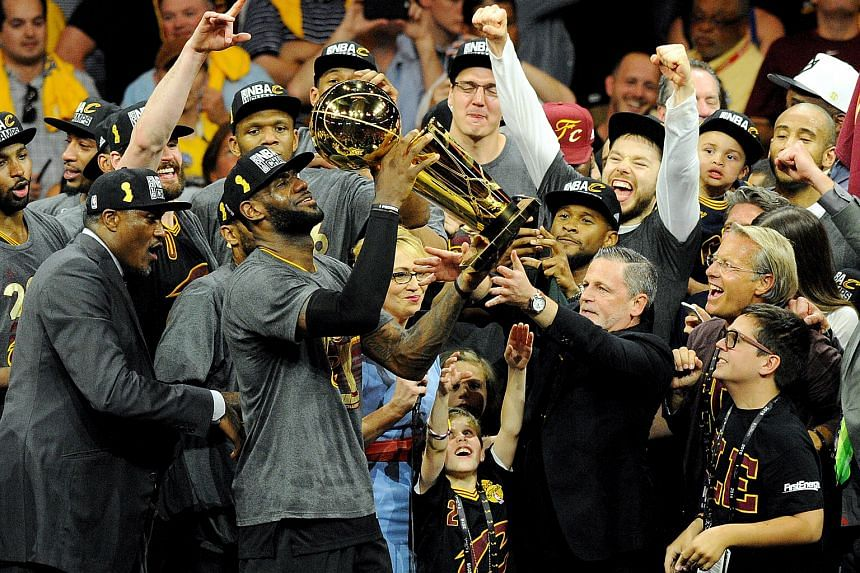Cleveland Cavaliers forward LeBron James (23) celebrates with the Larry O'Brien Championship Trophy after beating the Golden State Warriors in game seven of the NBA Finals.