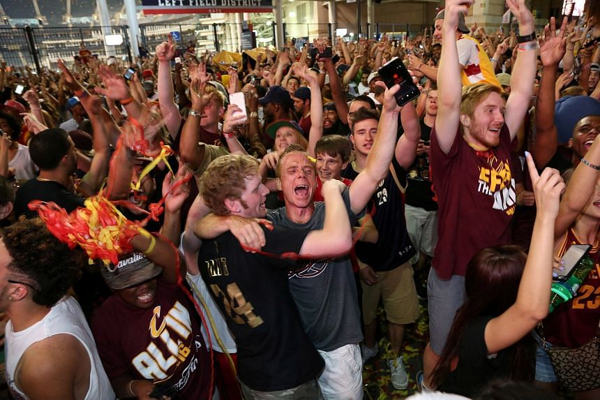 Cleveland Cavaliers fans rejoice at a watch party outside of Quicken Loans Arena in Cleveland, Ohio after the Cavaliers defeated the Golden State Warriors in the NBA Championship Game.