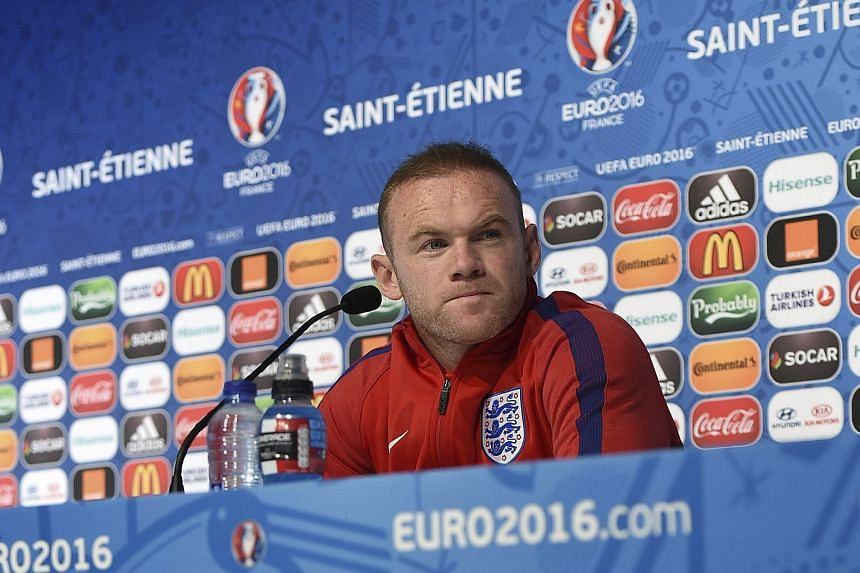 Wayne Rooney addressing a press conference at the Geoffroy-Guichard stadium in Saint-Etienne.