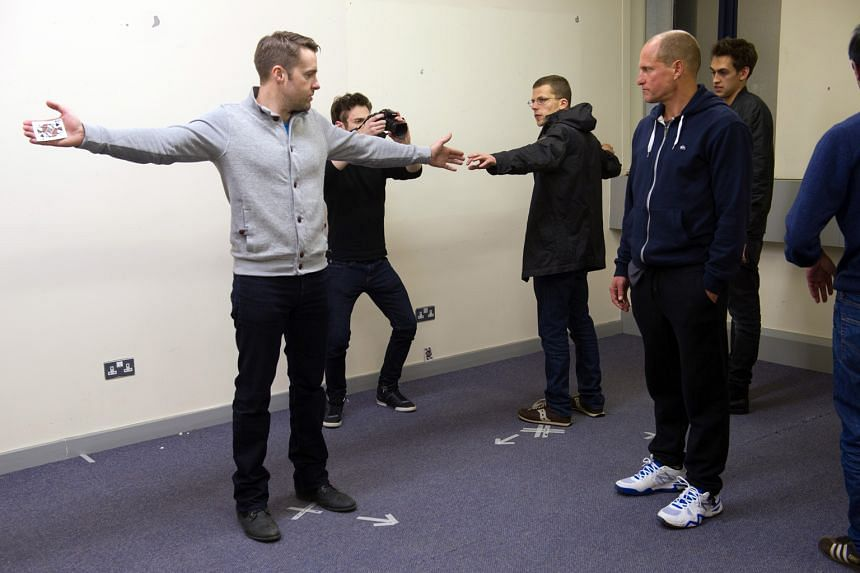 Magician Keith Barry (left) rehearsing with Now You See Me 2 cast members Jesse Eisenberg (third from left) and Woody Harrelson (above, in blue hoodie).