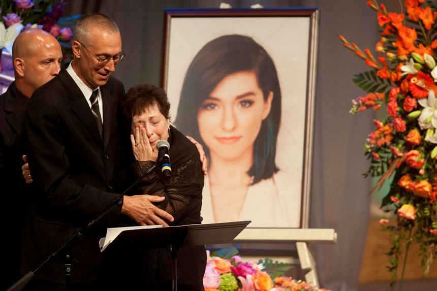 Tina Grimmie, mother of Christina Grimmie, is comforted by her husband Bud as she speaks during a memorial service held for the singer in New Jersey.