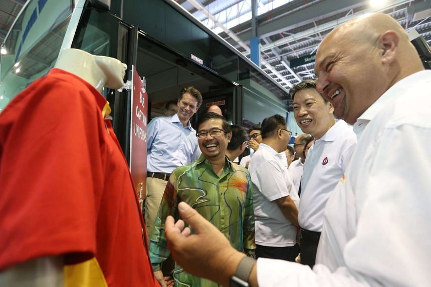 (From left) Go-Ahead group CEO David Brown, MP for Pasir Ris-Punggol GRC Zainal Sapari , National Transport Workers' Union executive secretary Melvin Yong and managing director of Go-Ahead Singapore Nigel Wood checking out a bus captain uniform at th