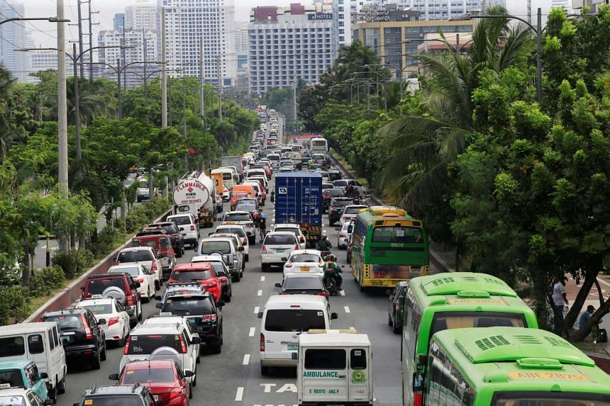 Motorists drive through heavy traffic along Roxas boulevard in Metro Manila, Philippines, on June 21, 2016.