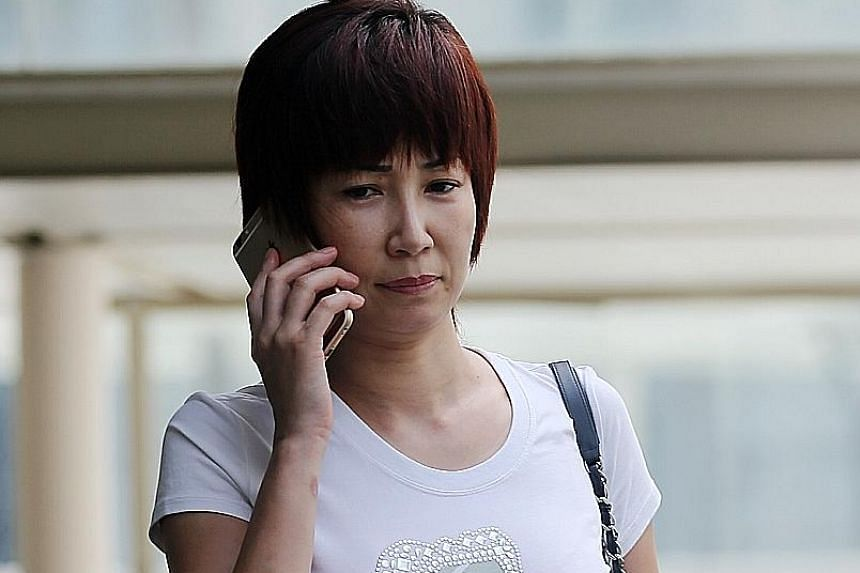 Guan lied to an anti-graft investigator about her former husband's two laptops, which she tried to hide from the CPIB.