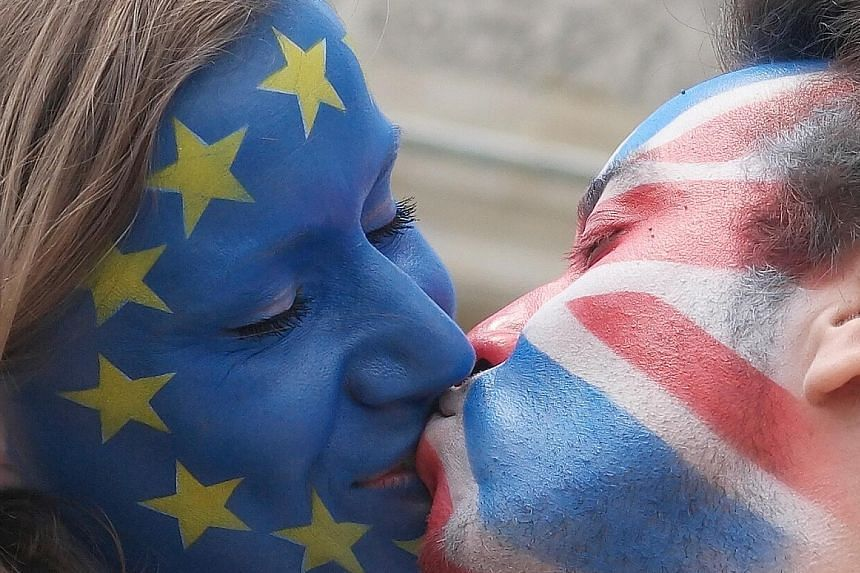 A couple with their faces painted in the flags of the European Union and Britain kissing in Berlin on Sunday. Similar action took place in several cities in Europe, with the aim of encouraging the British to vote in favour of remaining in the EU.