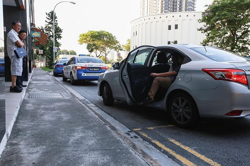 A passenger boarding a Uber car at Bishan Junction 8. The number of applications for taxi-driver vocational licences fell from 9,094 in 2013 to 7,968 last year.