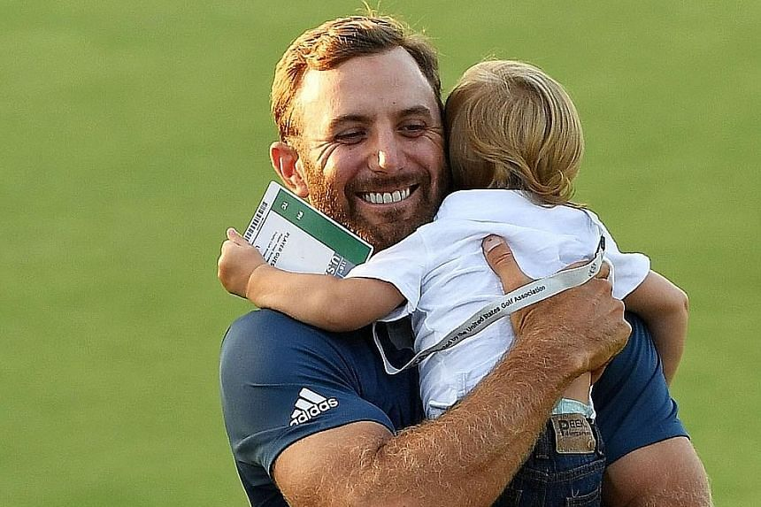 """Dustin Johnson celebrating with his son Tatum after winning the US Open at the Oakmont Country Club. The win marks his first Major win after a few near-misses, allowing the American to take himself out of contention for the unceremonious title of """"be"""
