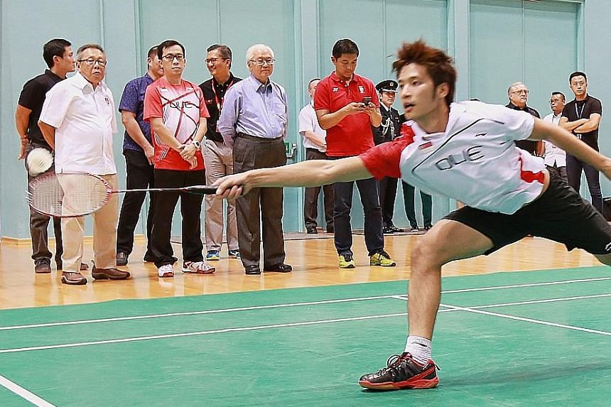 """President Tony Tan Keng Yam (sixth from left) watching Derek Wong in action during his visit yesterday to observe athletes training for the Rio Olympics and Paralympics. """"I hope that we'll win a few medals,"""" he said."""