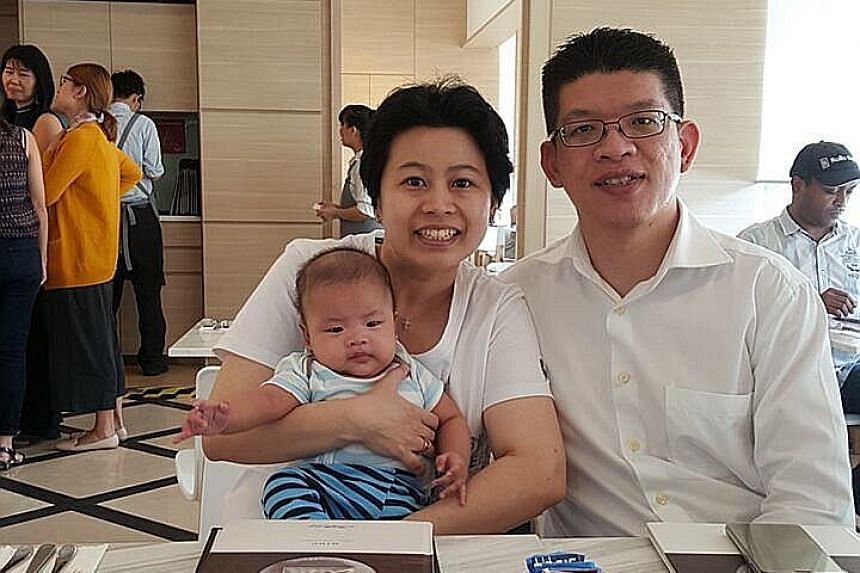 Ms Felicia Tan with husband Low Lieneng and their precious bundle of joy, Titus.