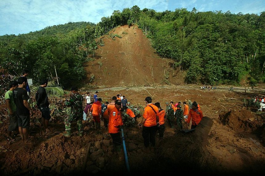 Rescue teams searching for victims of a landslide in Purworejo, Central Java. The national disaster mitigation agency has warned people in the province of the threat of more floods and landslides.