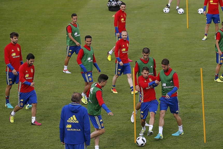 """The importance of topping their group to avoid a clash with Italy in the last 16 is not lost on defending champions Spain, seen here at a training session on Sunday. According to midfielder David Silva: """"We need to win or draw to stay top of the grou"""