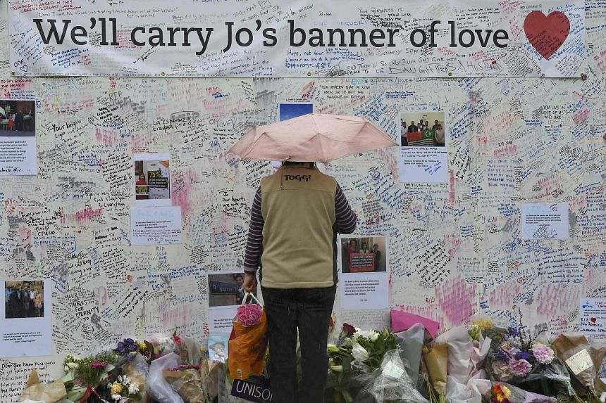 Tributes laid by the Syria Solidarity Campaign during a vigil in remembrance of slain British Labour MP Jo Cox (in photo) in Parliament Square in front of the Houses of Parliament in central London on Sunday.