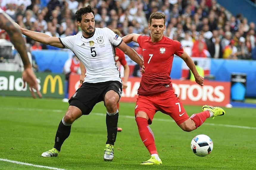 Poland's Arkadiusz Milik (right) and Germany's Mats Hummels in action in their Euro 2016 group C match on June 16.