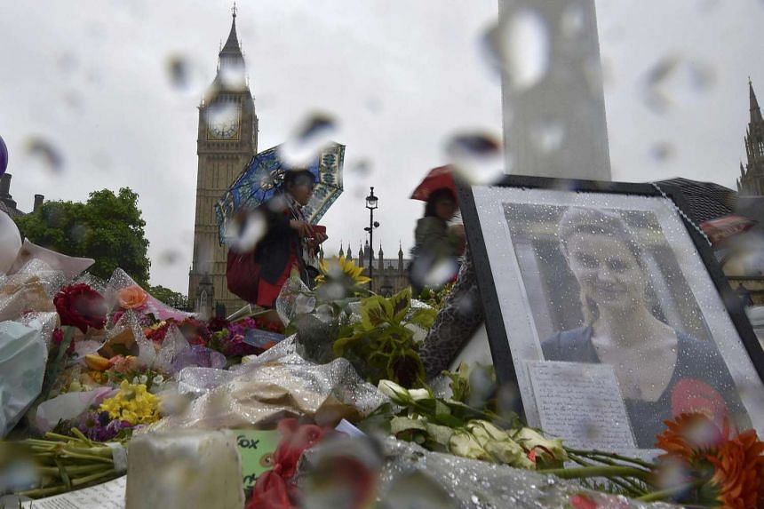 Tributes in memory of murdered Labour Party MP Jo Cox at Parliament Square in London on June 20.
