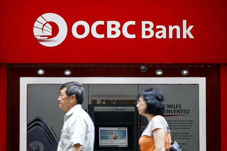 People pass by an OCBC ATM in Singapore's central business district on January 7. The bank is one such company where health and fitness are becoming a part of its corporate culture.