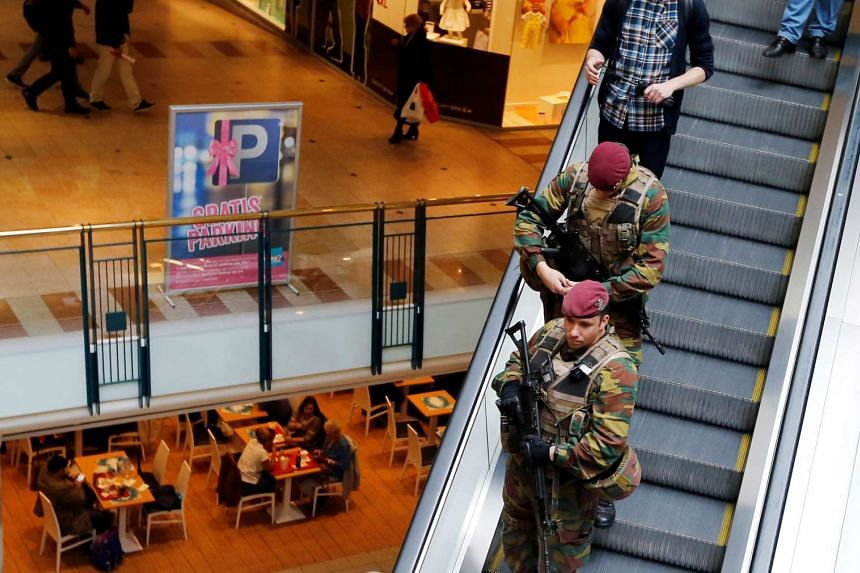 Belgian soldiers patrol in the shopping center City 2 in central Brussels, Belgium, on June 15, 2016.