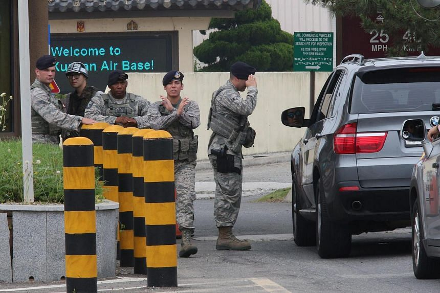 Guards at the main gate of a US air base in Gunsan, south of Seoul, on June 20, as vigilance has been beefed up amid an alleged threat by ISIS group to attack two American air bases in South Korea.