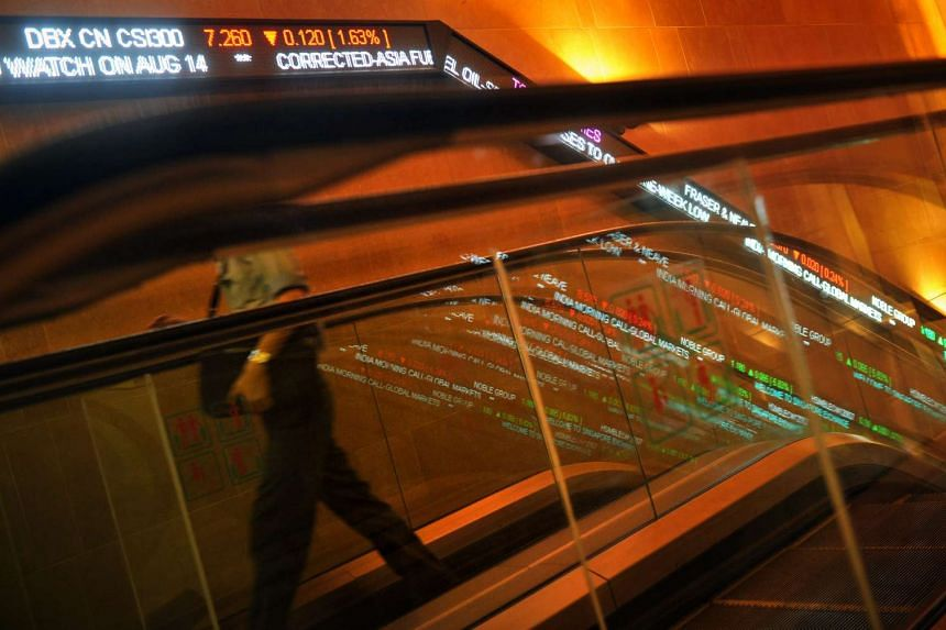 Stock tickers along the wall at the Singapore Exchange (SGX) Centre 1 building.