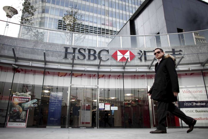 A man walks past the HSBC headquarters building in the Pudong financial district in Shanghai, on Dec 8, 2010.
