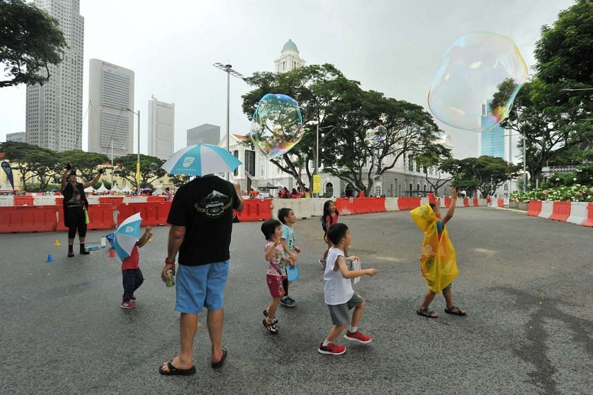 Children chasing bubbles at the Families for Life Celebrations 2016, held in conjunction with Car-Free Sunday SG, on May 29, 2016.