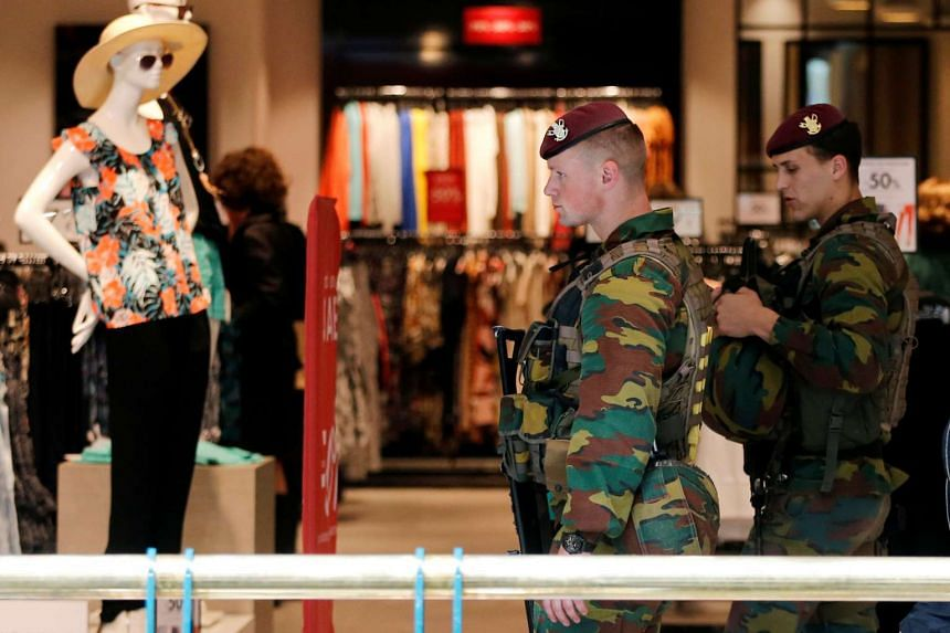 Belgian soldiers patrol in the shopping centre City 2 in central Brussels, Belgium, on June 15, 2016.