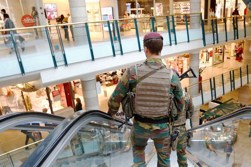 Belgian soldiers patrol in the shopping centre City2 in central Brussels, Belgium on June 15, 2016.
