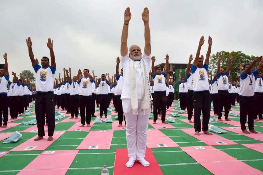 Indian Prime Minister Narendra Modi (centre) participates in a mass yoga demonstration at the Capitol Complex on the International Day of Yoga in Chandigarh, on June 21, 2016.
