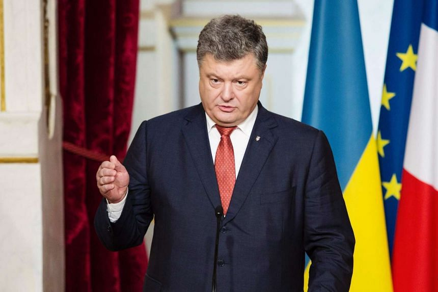 Ukrainian President Petro Poroshenko speaks at a press conference on June 21, 2016, at the Elysee palace in Paris.