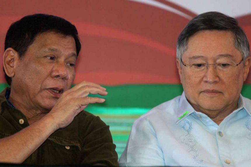 Philippine President-elect Rodrigo Duterte (left) speaks to his incoming finance secretary Carlos Dominguez at a conference with businessmen in Davao city, on June 21, 2016.