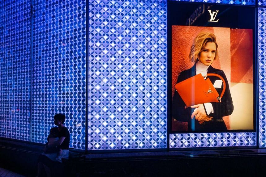 An advertisement for LVMH Moet Hennessy Louis Vuitton products in Hong Kong.